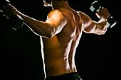 Caucasian man exercising with dumbbells, Saint Louis, Missouri, United States