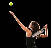 Caucasian tennis player serving the ball, Lehi, Utah, USA