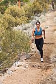 Hispanic runner training in remote area, Questa, New Mexico, USA