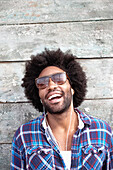 Smiling Black man listening to mp3 player, Los Angeles, California, USA