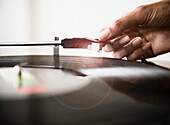 Cape Verdean woman listening to vinyl record, Jersey City, New Jersey, USA