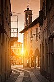 Sun shining in quaint alley, Orta San Giulio, Novara, Italy