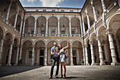 Caucasian couple sightseeing in plaza, Turin, Piedmont, Italy