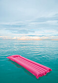 Inflatable raft floating in tropical water, Miami Beach, Florida, United States