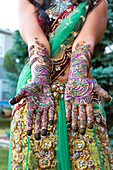 Close up of hands with intricate henna design, Chicago, Illinois, USA