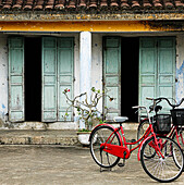 Red Bikes Parked in Front of a Weathered Building, Hoi An, Vietnam