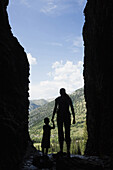 Caucasian mother and son exploring cave, Jackson, Wyoming, USA