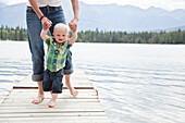 Caucasian mother and baby on dock over lake, Jasper, Alberta, Canada