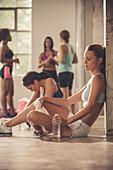 Women resting in gym, Saint Louis, Missouri, USA