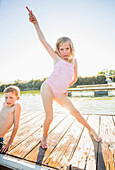 Caucasian girl posing on dock, American Fork, Utah, USA