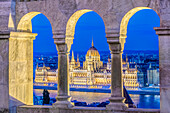 View of Parliament Building illuminated at dusk, Budapest, Hungary, Budapest, Central Hungary, Hungary