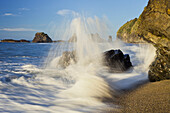 Waves crashing onto the beach at Ship Creek, West Coast, Tasman Sea, South Island, New Zealand