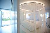 Double room with bed on a round platform and a mosquito net, Vourvourou, Sithonia, Chalkidiki, Greece