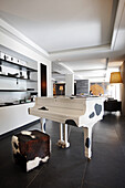 A cow print piano in a hote lounge, The Cambrian, Adelboden, Switzerland