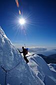 Mountaineer ascending the north face of Monte Sarmiento, Cordillera Darwin, Tierra del Fuego, Chile