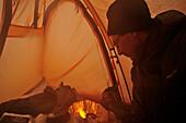 Cooking in a tent, base camp at Monte Sarmiento, Tierra del Fuego, Chile
