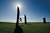 Man climbing at a rock, Standing Stones of Stenness, Mainland, Orkney Islands, Scotland, Great Britain