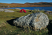 Child sitting in a tent, Sandwood Bay, Highlands, Scotland, Great Britain