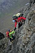 Climbers at pinnacle ridge, Sgurr nan Gillean, Cuillin, Isle of Skye, Scotland, Great Britain