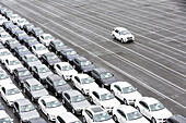 New cars on a parking area awaiting shipping in Bremerhaven, Germany