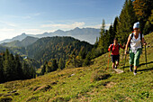 Women hiking to lake Taubensee, Reit im Winkl, Chiemgau, Bavaria, Germany