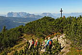 Women hiking along a ridge, Duerrnbachhorn, Reit im Winkl, Chiemgau, Bavaria, Germany