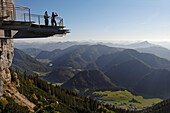 Female hikers enjoying view from observation platform at mount Steinplatte, Triassic Parc, Waidring, Tyrol, Austria