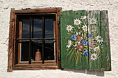 Window shutter of a mountain hut, Eggenalm, Waidring, Tyrol, Austria