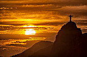 Statue of Christ on the top of Corcovado Hill at sunset, Rio de Janeiro, Brasil, South America