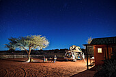 Bonfire under the stars in the desert camp in the Kalahari Desert, 4x4 rooftop tent, Namibia, Africa