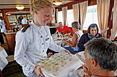 Service in the restaurant of the historic canal boat Juno, Gota canal, Sweden