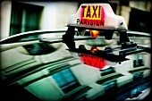 Taxi Parisien sign, on a street in Paris, France