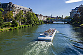 Sightseeing tour boat on Ill river Strasbourg Alsace France.