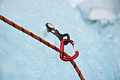 Climbing rope and carabiner, close up
