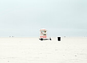 Man standing inside ice cream van on remote beach