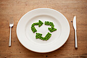 Peas in shape of recycling symbol