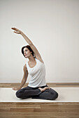Mature woman stretching arm