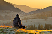 Man alone at sunrise, Krasnik village area, Carpathian Mountains, Ivano-Frankivsk region, Ukraine