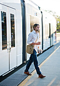 Male commuter at train station
