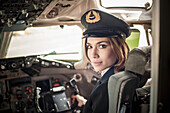 Female pilot in aeroplane cockpit