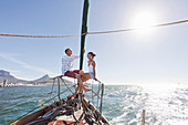 Young couple on deck of yacht