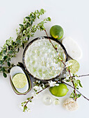 Aromatic still life with limes, blossom and soap