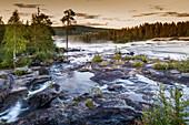 View of river flowing over rocks, Storforsen, Lapland, Sweden