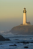 Waves and coastal rocks at Pigeon Point Lighthouse at sunrise, San Mateo County coast, California.