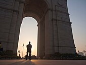 Security guard standing at India Gate in New Delhi, India.