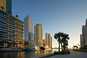 'sunrise on Miami River skyline sunrise, Miami, FL (Epic Hotel, left; Bayfront & Intercontinental, center).'