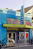 Key West Florida USA classic restored Tropic Cinema with Marilyn Monroe statue in historic district.
