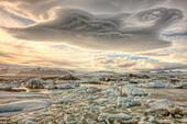 Lenticular Clouds Over The Ice Lagoon Of Jokulsarlon, Iceland