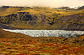 Tundra In Fall Colours With A Glacier Running Through One Of The Valleys In Skaftafell National Park, Iceland