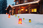 Log Home Decorated With Christmas Lights And Luminaries On The Walkway, Anchorage, Southcentral Alaska/N{Digitally Altered)